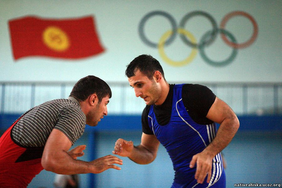 Hasan Hamdiev (right) spars with his team-mate Husniddin Yusupov during his wrestling class in Bishkek.